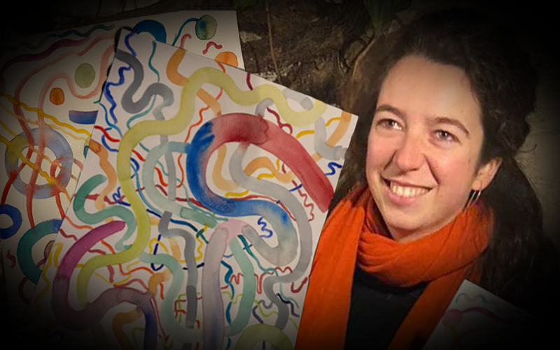 Artist holding the paintings of her migraines