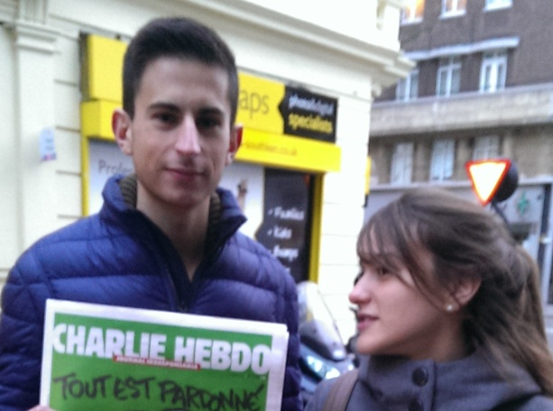 Charlie Hebdo people with front cover swl