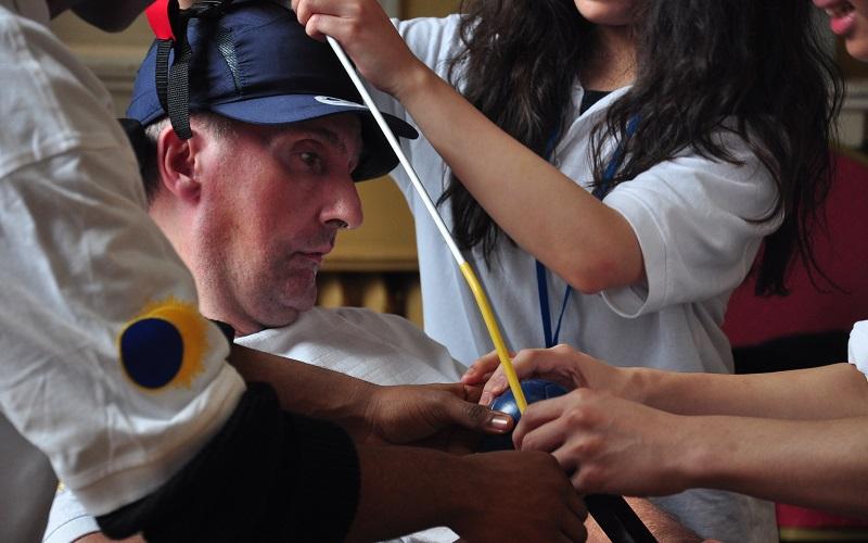 An RHN resident prepares to play boccia
