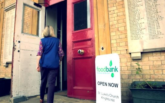 person walking in to a foodbank
