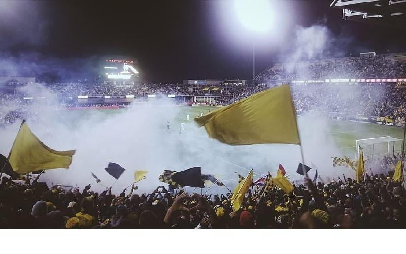 Football fans enjoying a competitive fixture