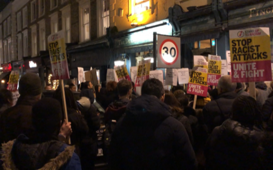 Protesters gather outside the Duke of Wellington Pub