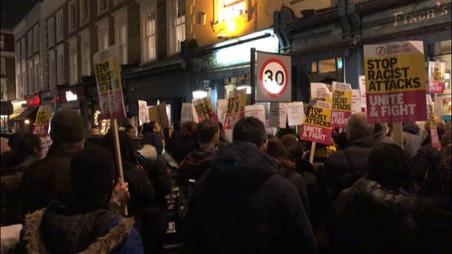 Protesters gather outside the Duke of Wellington Pub