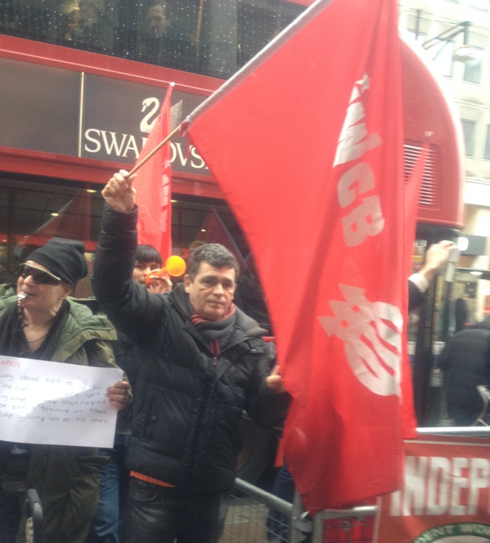 John Lewis London Living Wage protest man flag
