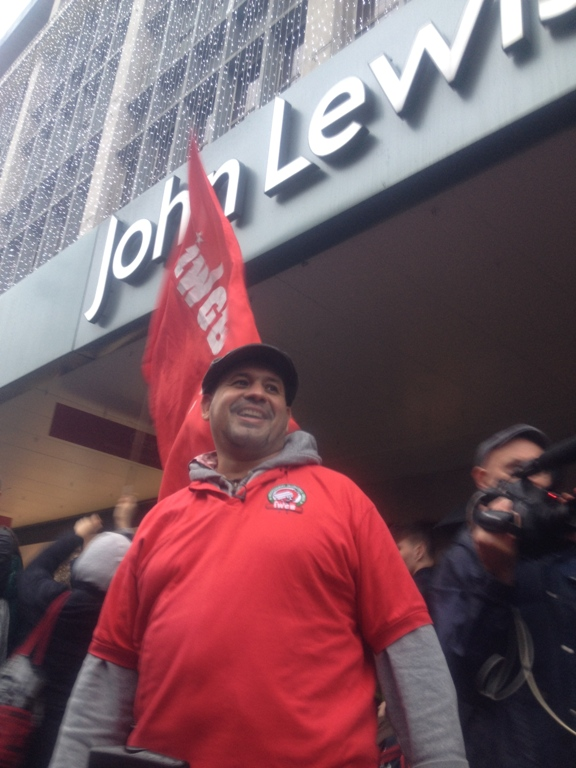 John Lewis London Living Wage protest man flag2