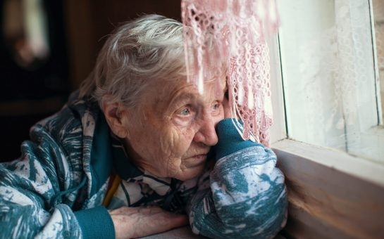 An elderly lady at home alone during the Coronavirus isolation measures