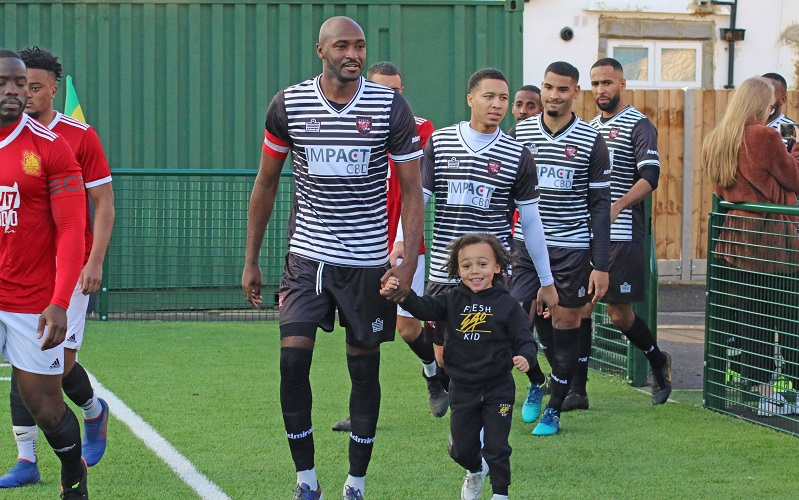 Morgan leads out team with son Miles