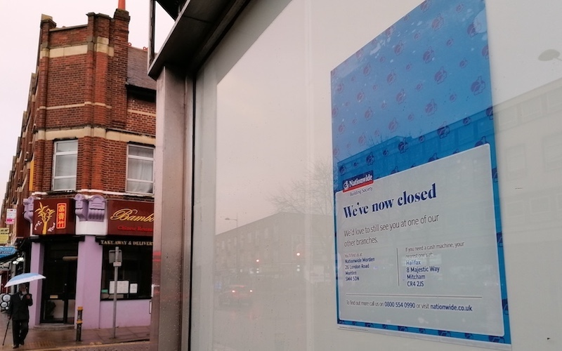 A poster in the window of the old Nationwide building in Mitcham announces the closure