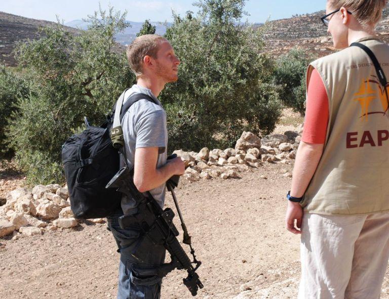 Nikki speaking with an Israeli settler who entered the Palestinian village of Yanoun where she was based
