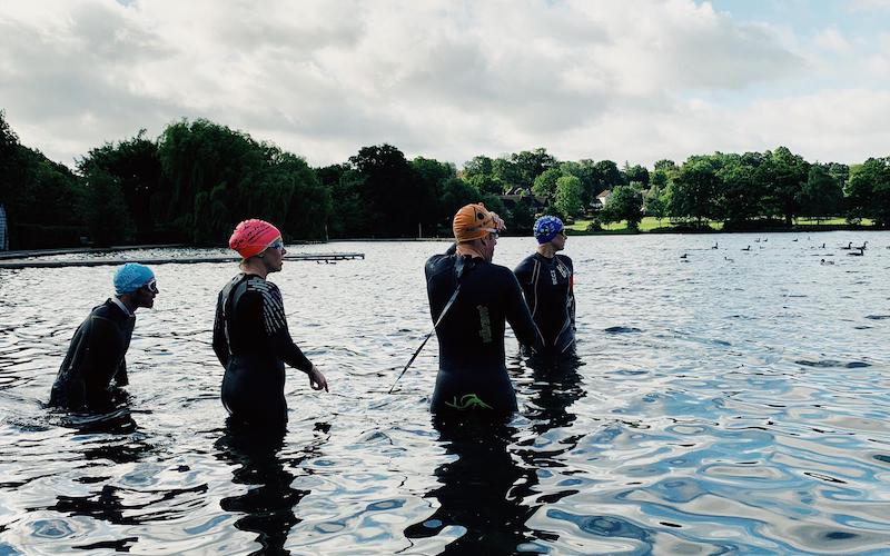 Wetsuit-clad swimmers test the water in Wimbledon Park