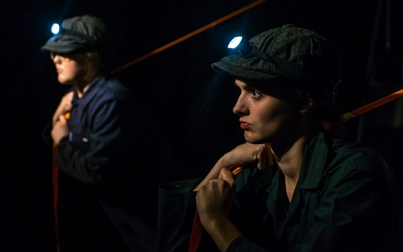 TALK PROPA actors on stage in flat caps