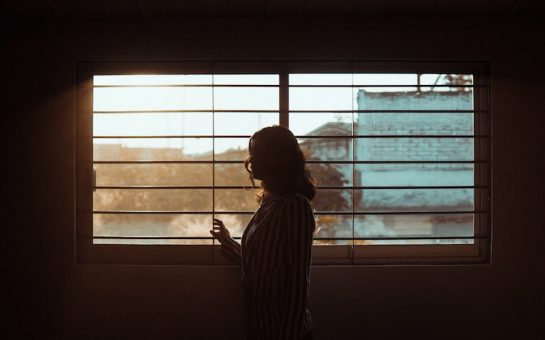 A woman alone at a window