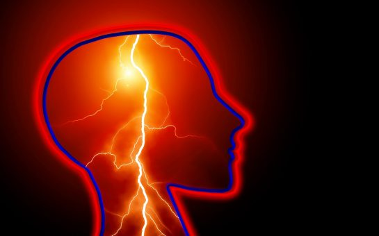 Profile of human head with lightening bolts inside
