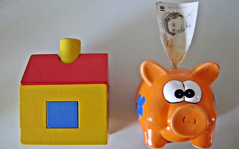 A toy house and a piggy bank