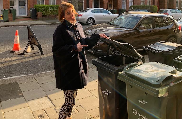 Annemarie Plas opening her wheelie bin in Streatham