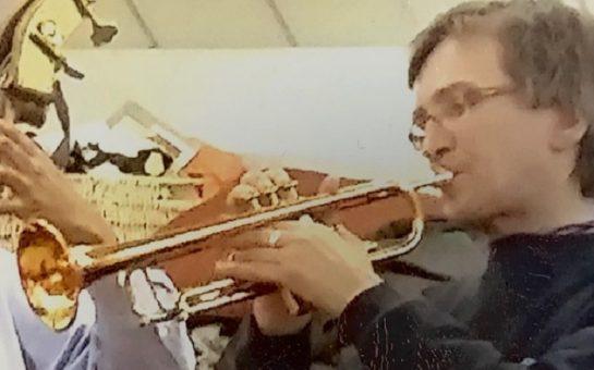 William Blaise Algar playing the trumpet