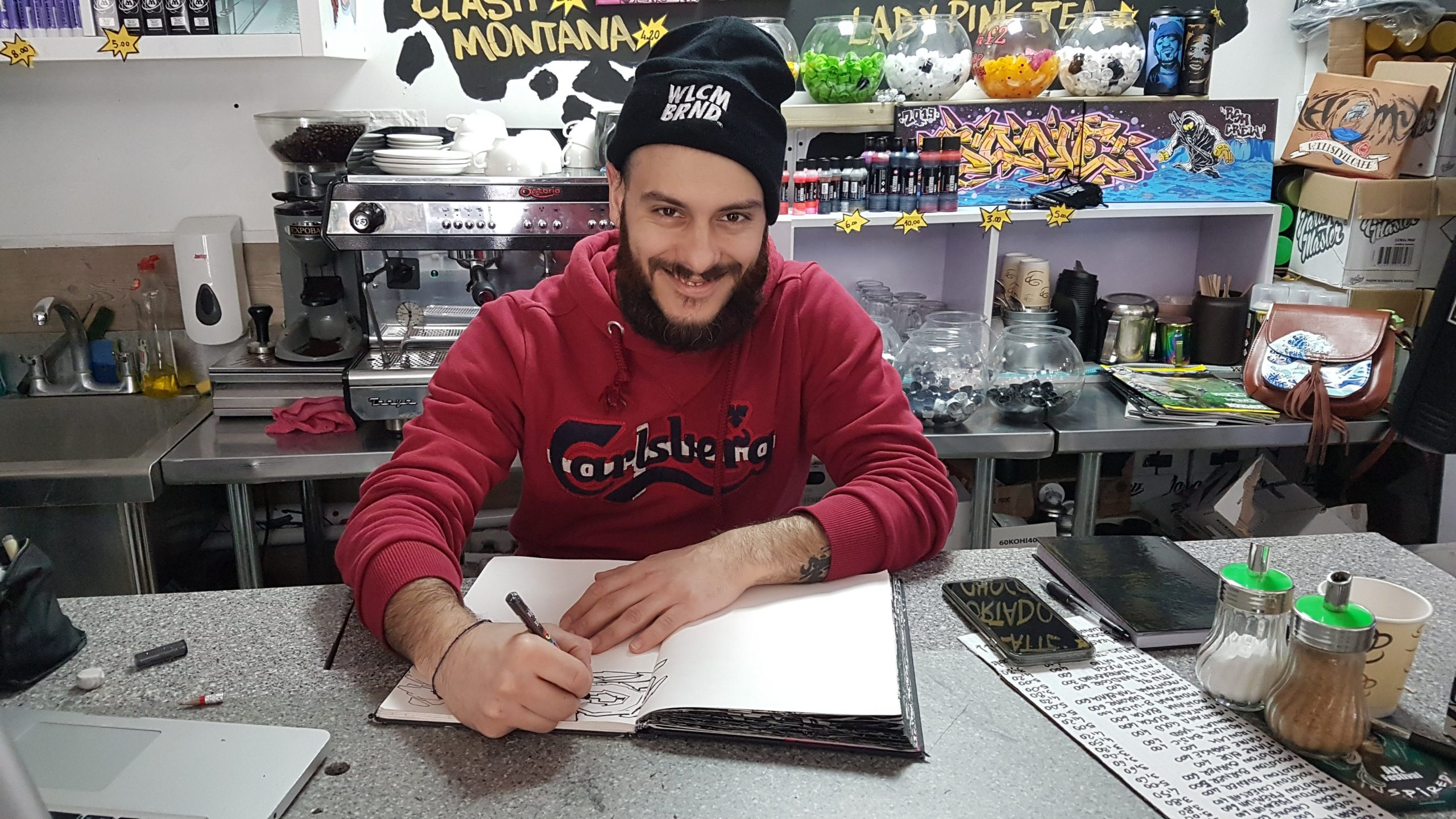 LIVING THE DREAM: Chips sketches in his shop