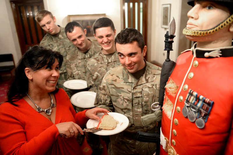 Credit - Sgt R Frere RLC MOD Crown Copyright LOND-2014-163-Guards Cake-146 Rosie and the guards serving up cake