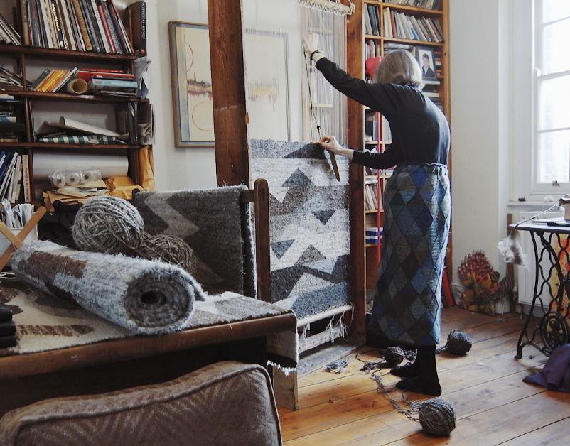 Rachel Scott, weaver, at home weaving a rug