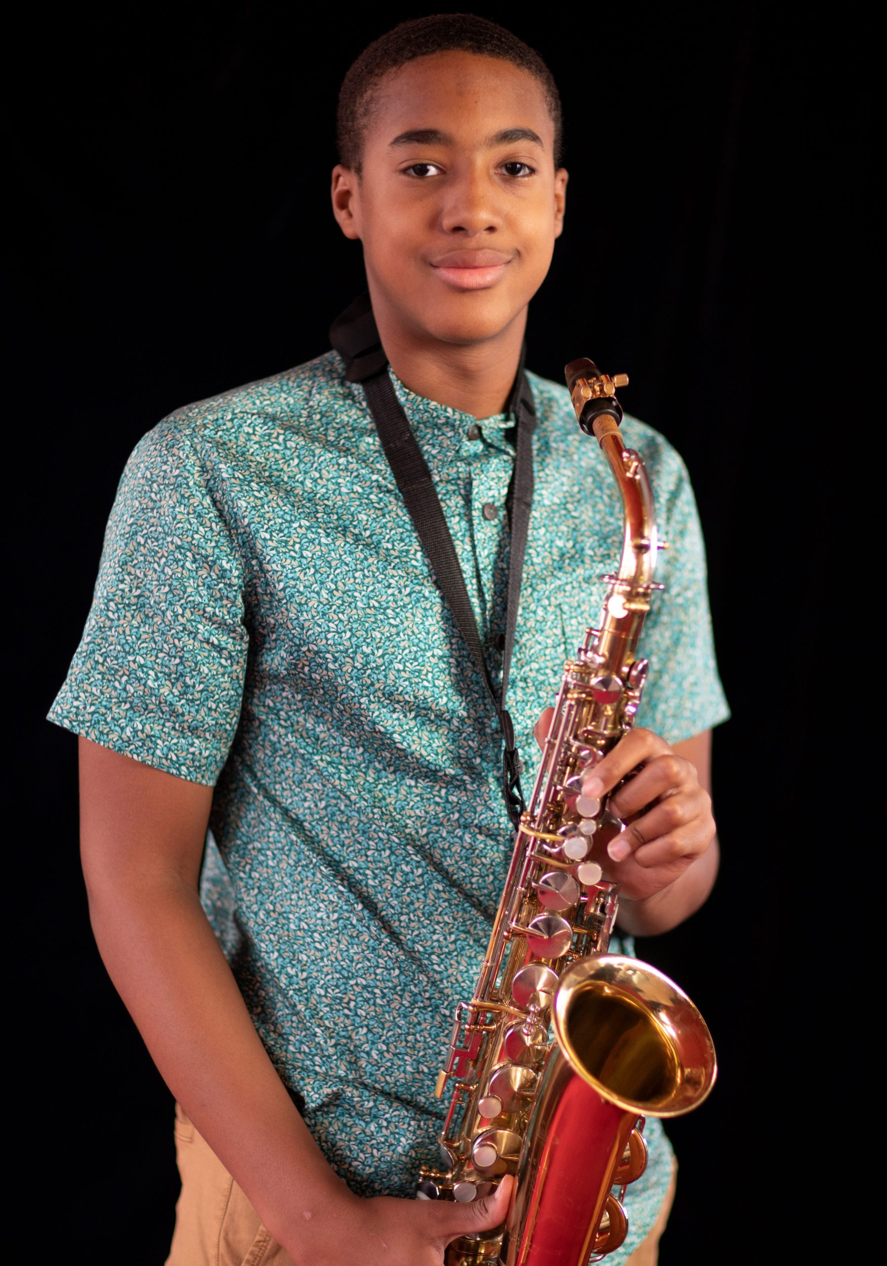 Toku Ogwang, one of the students selected for the jazz programme is pictured with his saxophone.