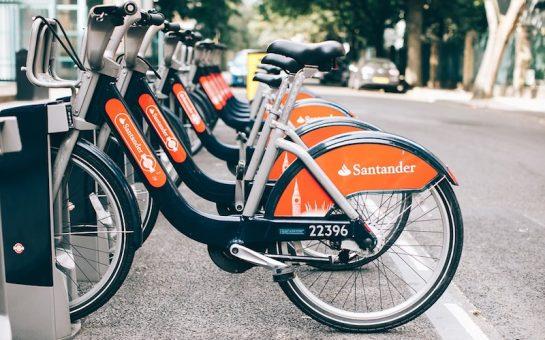 Orange and black Santander hire bikes parked in London