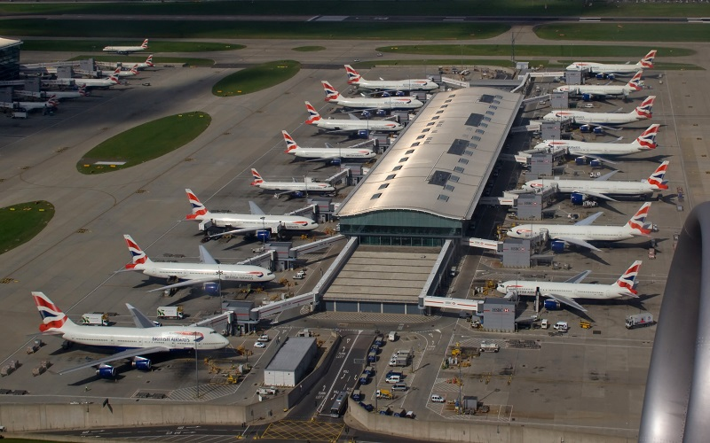 15 planes facing each other in two lines at an airport