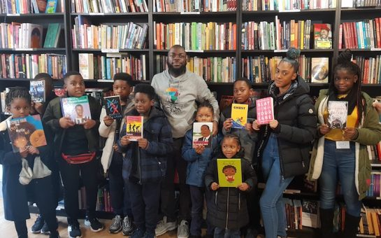 Darrel Blake with kids from Black Rooted Academy at New Beacon Books
