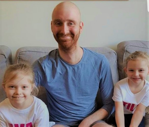 Bradley with Ava (left) and her younger sister Tilly (right) before the mini-marathon.