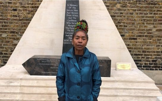 Councillor Sonia Winifred standing by memorial statue