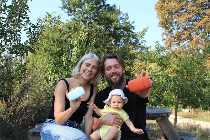 Woman man and baby on bench holding natural deodorant