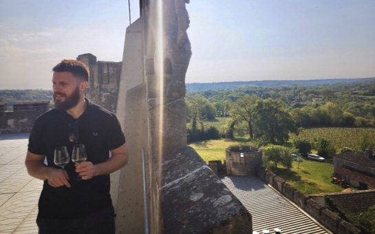 Jon Clements tasting wine at a winery