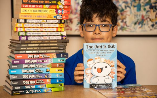 £5 million in library fines across London as 10-year-old Nicholas Hampartsoumian with a selection of books