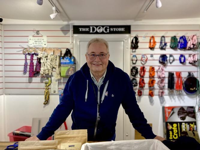 Man behind counter in pet shop