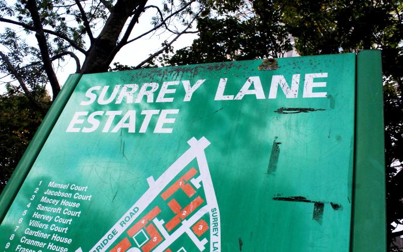 "A green sign reads ""Surrey Lane estate"""