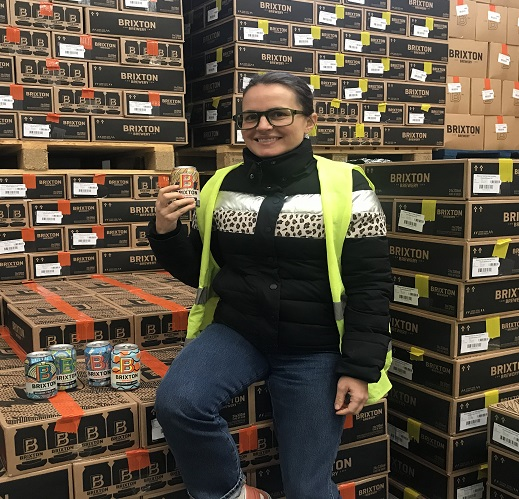Co-founder Xochitl Benjamin with award-winning cans at Brixton Brewery