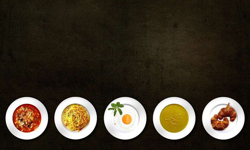 expensive dishes against a black background