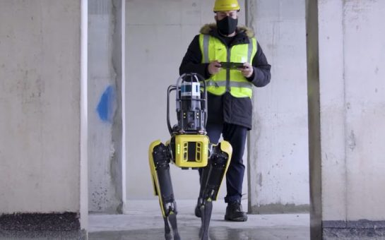 robot dog and construction worker