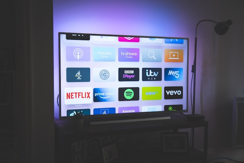 A smart Tv with various apps showing onscreen, including Iplayer