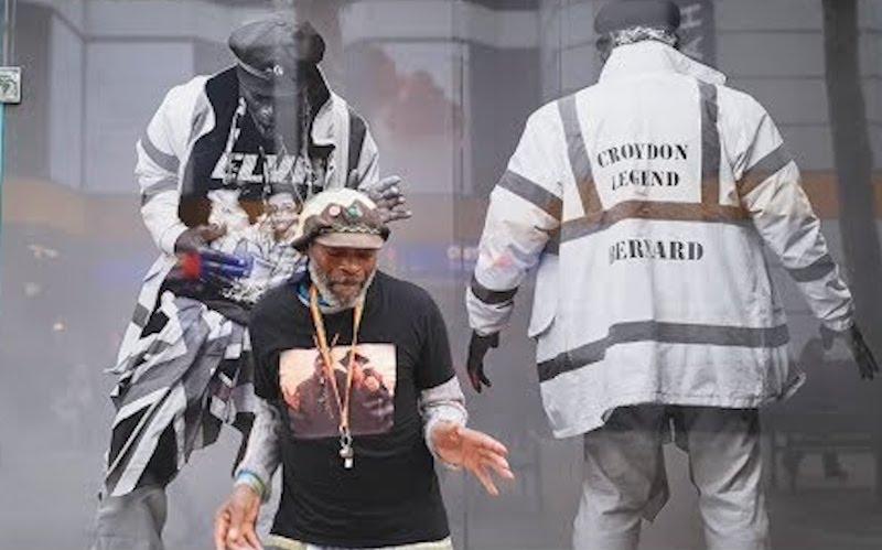 croydon legend bernard dances in front of tribute wall