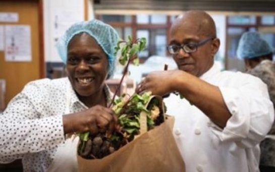 two share community workers packing food