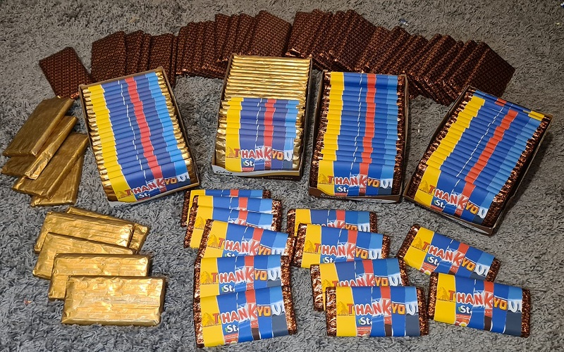 Several chocolate bars wrapped up in wrappers that read 'thank you'