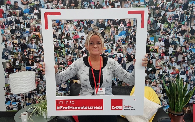 sutton homelessness support worker and MBE with a frame surrounded by pictures