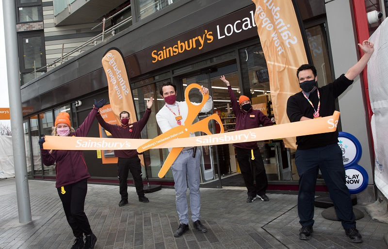 The ribbon is cut for the opening of Sainsbury's Local outside Twickenham Stadium