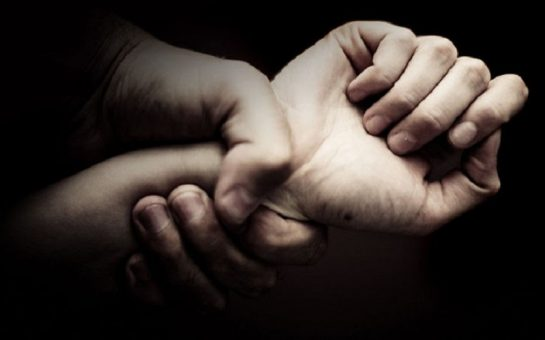 domestic violence picture of one hand grabbing an arm