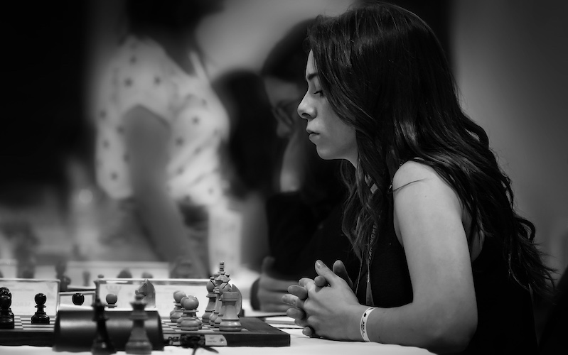 Dina Belenkaya playing chess black and white