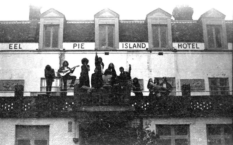 Eel Pie Island Hotel in 1969 members of the commune sit on the hotel's balcony. Photo Credit: Mark Pickthall