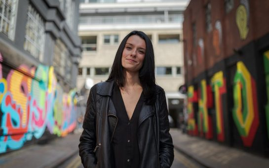 Love and London founder Jessica Dante stands facing the camera in a side street. Credit Jessica Dante