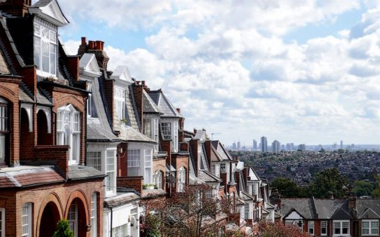 An image showing the London skyline from a suburb view