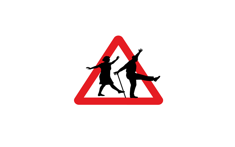 Read triangle road sign, with two elderly people dancing across the sign. The man has a walking stick