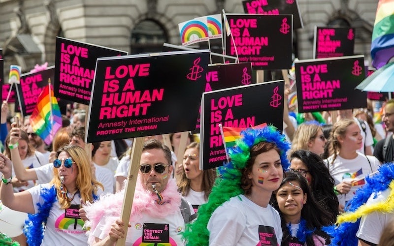 Image of LGBTQ campaigners on the streets in London with placards